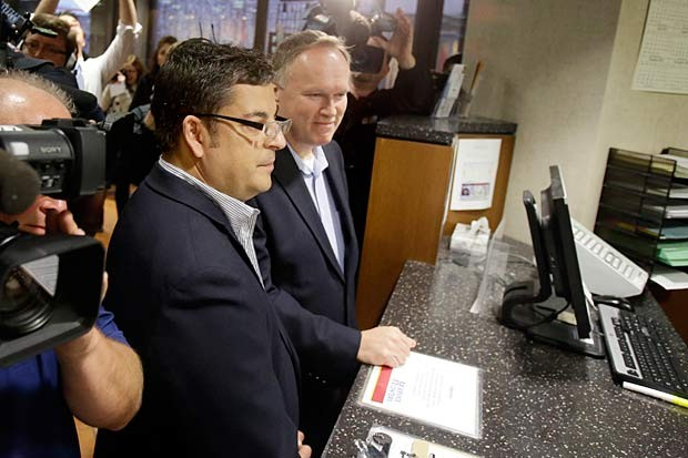 Al Giraud, left, and Jeff Isaacson apply for their marriage license at the Hennepin County Government Center Thursday, June 6, 2013 in Minneapolis, Minn. (Jim Mone/AP Photo)